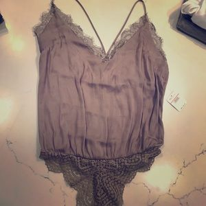 Free people cami bodysuit with lace detail. Xs NWT